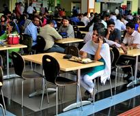 Fearing tighter US visa regime under Trump, Indian IT firms rush to hire, acquire