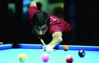 World 9 Ball Championship continues in Doha Qatar's Ali Abdulhadi AlMeri takes aim during his match against Christ...