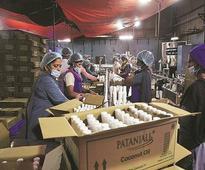 Patanjali Ayurveda planning online push; to tie up with Flipkart, Amazon