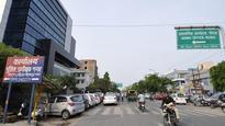 Unauthorised parking chokes traffic on one-way Udyog Marg