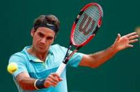Roger Federer attends Abu Dhabi GP: 'I will play Hopman Cup'