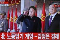 N. Korea fires missiles, liquidates South assets