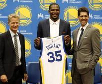 Warriors unveil Durant after signing him to two-year deal