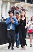 Jude Law cuts a cool figure in a wide brim hat and denim jacket in London