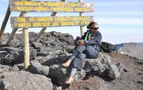 Sassy 'princess' put on her gold heels when she reached Kilimanjaro summit on Trek4Mandela