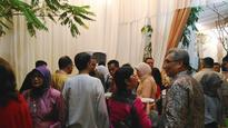 OJK boss has full house while welcoming guests during Idul Fitri