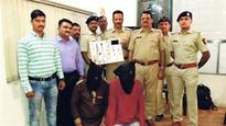 Two held for snatching bag containing Rs 5.71 lakh valuables