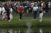 Golf-Johnson to launch Masters title bid with Watson, Walker