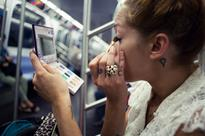 Why I Love Watching People Do Their Makeup on the Subway