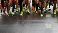 Marathon runners chase the 'impossible' time