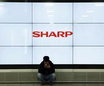 Sharp to buy back 159 million pounds in preferred shares