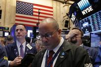 Wall Street retreats after S&P, Nasdaq hit record highs
