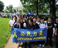Open up or break up, dissident Yang Jianli tells China
