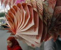 Rupee rises; dollar inflows cushion it in March quarter