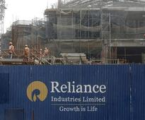 Reliance Industries shares surge to 7-1/2-yr high on plans for telecom unit