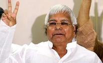 Nitish, Lalu bond over 'dahi-chuda'; Sushil Modi skips feast