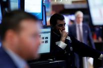 Wall Street ending bumpy week, solid first half on high note
