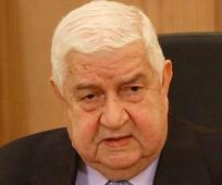 Syria's Foreign Minister al-Moallem: Foreign Troops Entering Syria Would Return 'in Coffins'