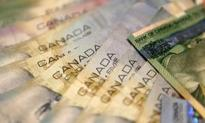 Loonie pressured by jobs loss, lower oil prices