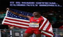 Bromell strikes gold on day of drama