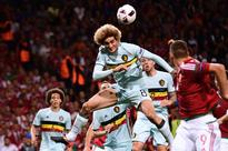 Belgium trounce Hungary 4-0 to set up Wales cl... Belgium's midfielder Marouane Fellaini (cetre) jumps for the ball during...