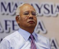 UPDATE 1-Malaysian PM says police to investigate Wall Street Journal over leaked document