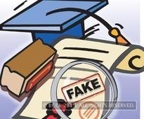 Father, son held in fake degree racket