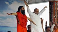 Shah, Ramdev perform Yoga in Faridabad; Khattar, Solanki attend UT event