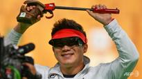 Olympics: South Korea's Jin wins record third 50m pistol title