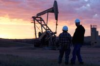 Oil prices slide as global economic woes continue
