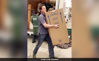 The Real Story Behind Viral Pic of David Cameron Moving House