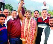 Jammu wrestler Akram lifts Bhagtha Dangal title