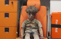 Assad's propaganda hits new low: Photo of Syrian boy harmed in airstrike was 'manipulated'