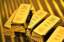 Gold futures spurt Rs 124 on global cues