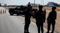 Police helicopter shot down during raid on Mexico cartel