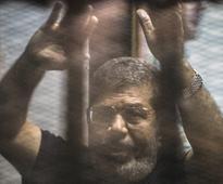 Egypt court sentences ex-president Mohamed Morsi to 40 years in jail for espionage