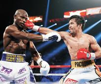 Pacquiao weaves past scandal back into ring