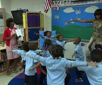 Video: Michelle Obama gets her groove on with school kids