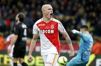 Monaco boost Champions League hopes with Nice ... Monaco's Andrea Raggi reacts after Monaco scored against Nice. REUTERS/E...