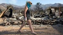 The Latest: Barbecue-sparked wildfire contained in Utah