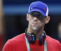 Mischievous Phelps leaves door ajar for sixth Games