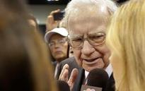 The Latest: Berkshire investors reject climate change report