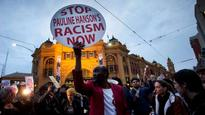 Rally to support anti-racism protester blocks Flinders Street