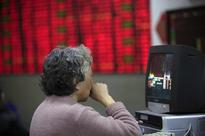 Asian shares rise, but Japan down on tax reports