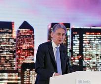 UK finance minister Hammond says 2015 tax promises hamper government