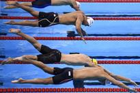 US swimmer Adrian cuts it fine for Phelps party