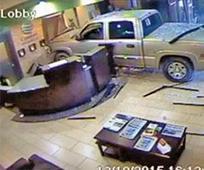 Man slams car into hotel lobby after row
