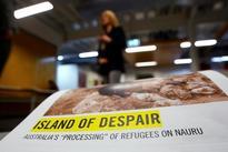 U.S. officials meet asylum seekers at Australian-run camp, possibly restarting 'dumb deal'