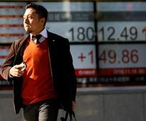 Asia stocks trim gains as liquidity fears jolt China markets