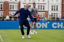 McEnroe ends coaching partnership with Raonic